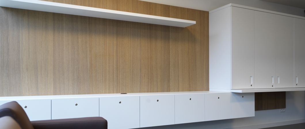 White cabinets in W1001 match wall panels featuring a woodgrain design.