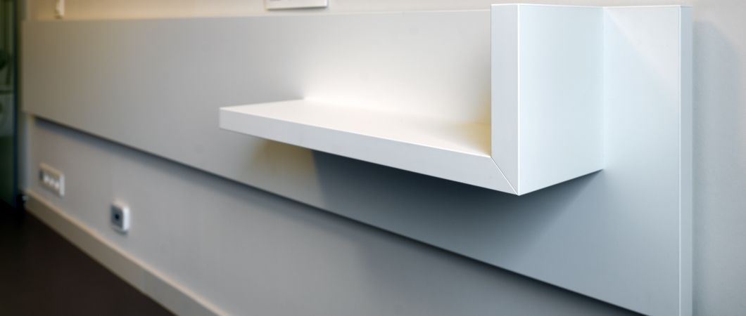 Headboard: This ensures the wall is protected and a night table is also integrated.