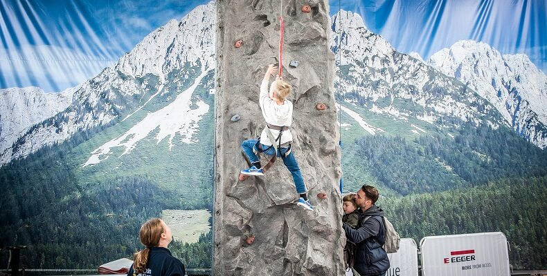 Children and adults could have a go on the climbing wall with Austrian alps in the background.