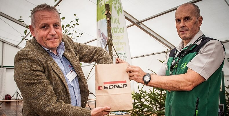 John Paterson, director of EGGER Forestry (left) picked out the ticket for the Forestry Commission's raffle with Simon Banks, works supervisor at the Forestry Commission (right).