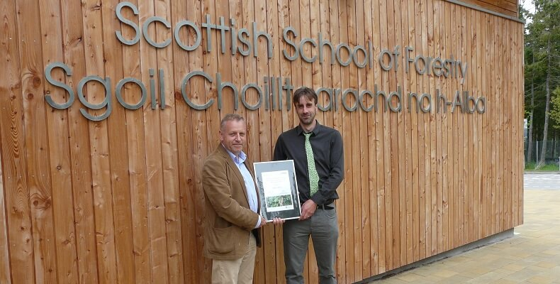 John Paterson, director of EGGER Forestry, awarded first prize to Callum Wilson at the Scottish School of Forestry.