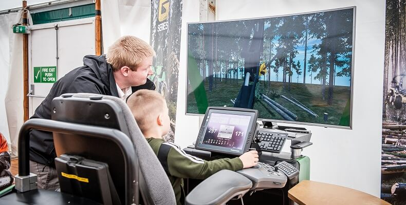 A young visitor on a forestry simulator