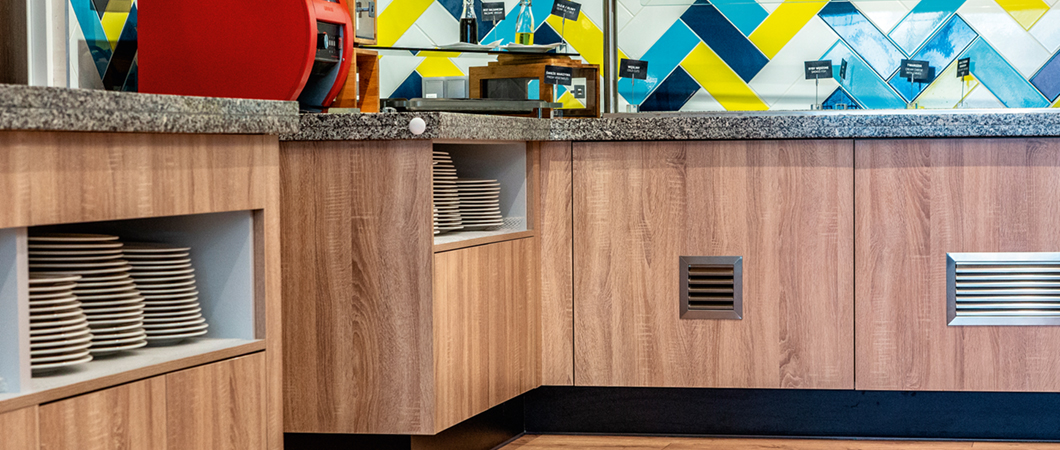 The cabinets in the buffet area feature H1145 ST10 Natural Bardolino Oak.
