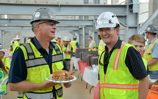 Gray's Site Manager Kendall Kluttz, left, and Gray's President and CEO Stephen Gray enjoy traditional North Carolina barbecue during a safety lunch sponsored by Gray.