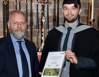 John Paterson, Director of EGGER Forestry (left) presenting the prize to Robert Baker (right).