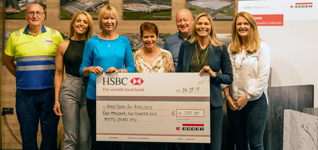 Paul Ross, Victoria Hodgson, Karen Hunter, Andrea Evans, Bob Livesey and Kate Wallace from EGGER present £4,230 to Angela Doran from the Great North Air Ambulance