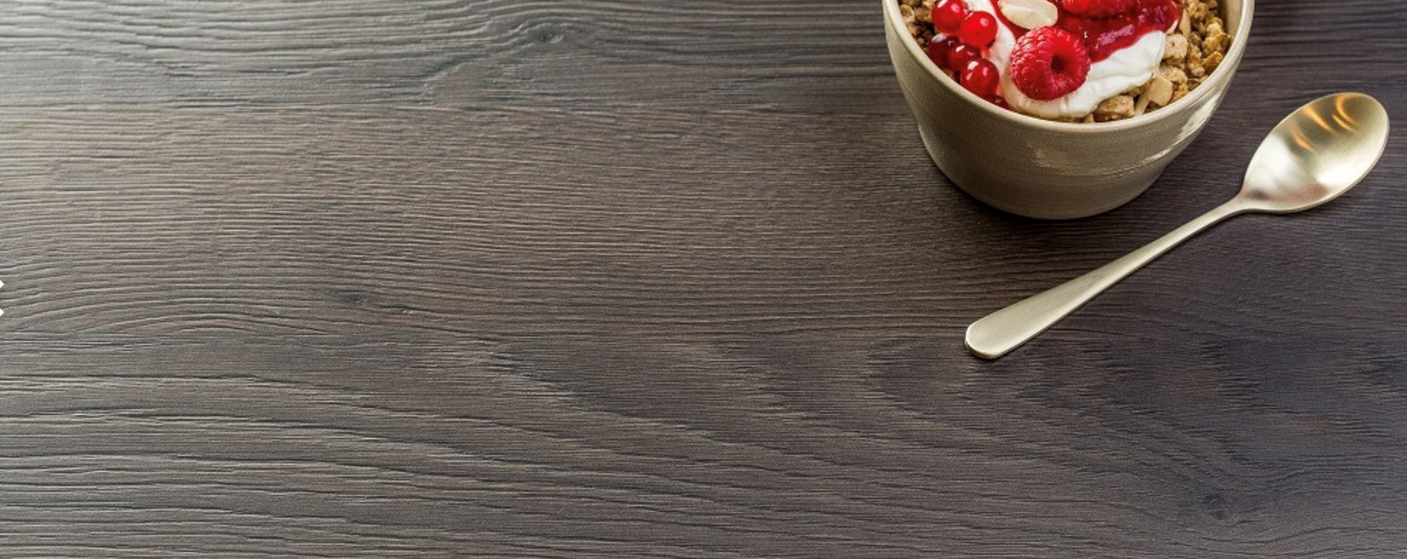 Feelwood's Anthracite Mountain Larch decor accentuates the classic warm rustic feel.