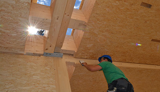 Timber beam ceiling closed on both sides with OSB