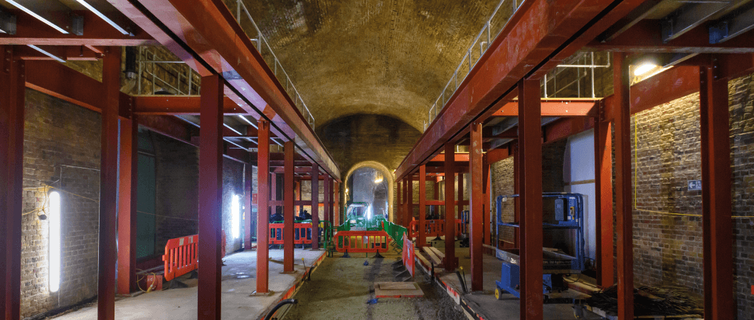 The Rolled Steel Joists (RSJ), manufactured by LA Metalworks, which the OSB HDX boards were fixed to, to create mezzanine flooring platforms in the arches. © Mark Mackenzie Photography